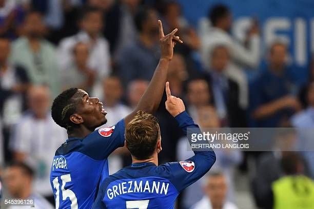 TOPSHOT France's forward Antoine Griezmann celebrates with France's midfielder Paul Pogba after scoring his team's second goal during the Euro 2016...