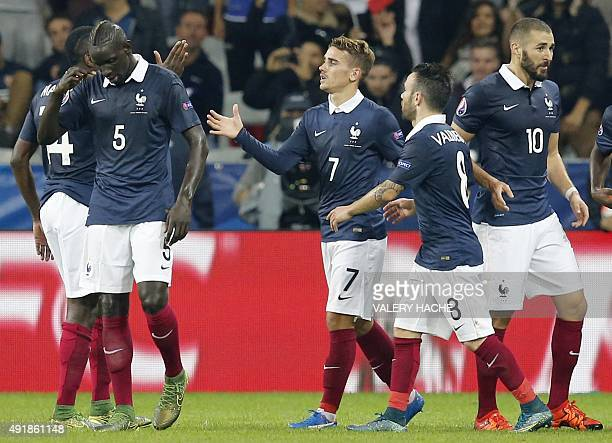 France's forward Antoine Griezmann celebrates with teammates after scoring a goal during the friendly football match between France and Armenia on...