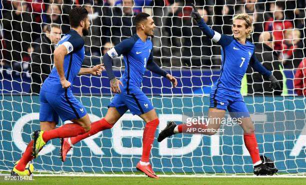 TOPSHOT France's forward Antoine Griezmann celebrates with teammates after scoring a goal during the friendly football match between France and Wales...