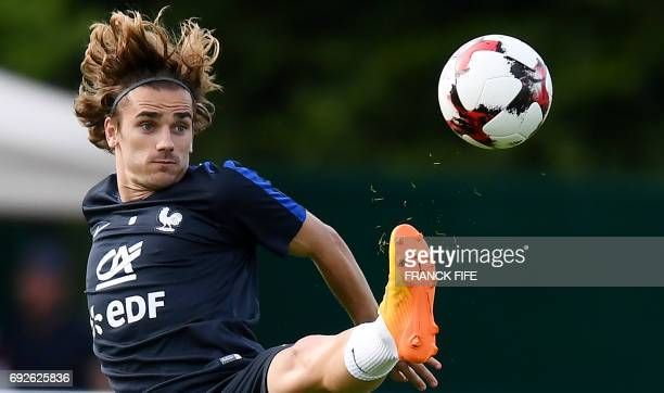 TOPSHOT France's forward Antoine Griezmann controls the ball during a training session in ClairefontaineenYvelines on June 5 2017 as part of the...