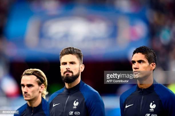 France's forward Antoine Griezmann France's forward Olivier Giroud and France's defender Raphael Varane look on before the the FIFA World Cup 2018...