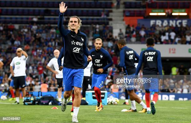 France's forward Antoine Griezmann gestures as he warms up ahead of the the FIFA World Cup 2018 qualifying football match France vs Luxembourg on...