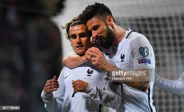 France's forward Antoine Griezmann is congratuled by France's forward Olivier Giroud after scoring a goal during the FIFA World Cup 2018 qualifying...