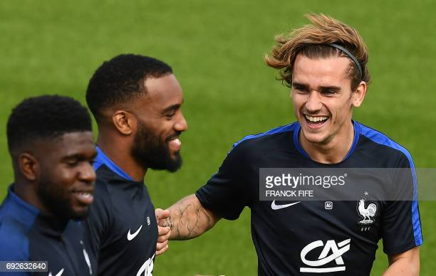 France's forward Antoine Griezmann jokes with France's forward Alexandre Lacazette during a training session in ClairefontaineenYvelines on June 5...