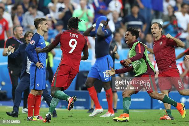 France's forward Antoine Griezmann looks on as Portugal's forward Eder celebrates after scoring a goal during the Euro 2016 final football match...