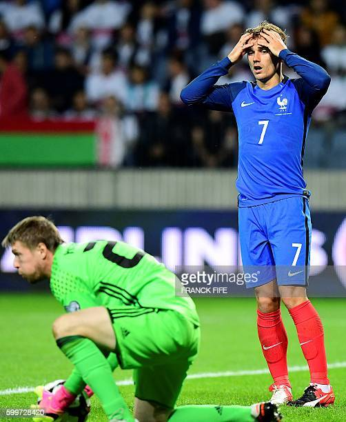 France's forward Antoine Griezmann reacts after missing a goal opportunity during the FIFA World Cup 2018 qualifying football match Belarus vs France...