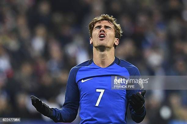 France's forward Antoine Griezmann reacts after missing a goal opportunity during the 2018 World Cup group A qualifying football match between France...