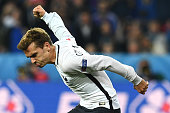 TOPSHOT France's forward Antoine Griezmann reacts during the Euro 2016 group A football match between Switzerland and France at the PierreMauroy...