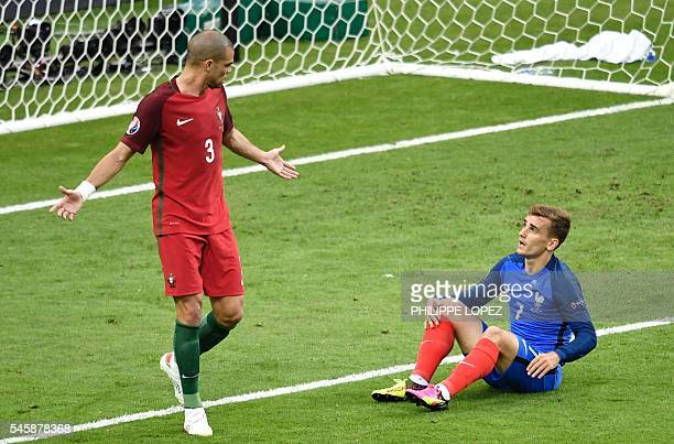 TOPSHOT France's forward Antoine Griezmann reacts next to Portugal's defender Pepe during the Euro 2016 final football match between Portugal and...
