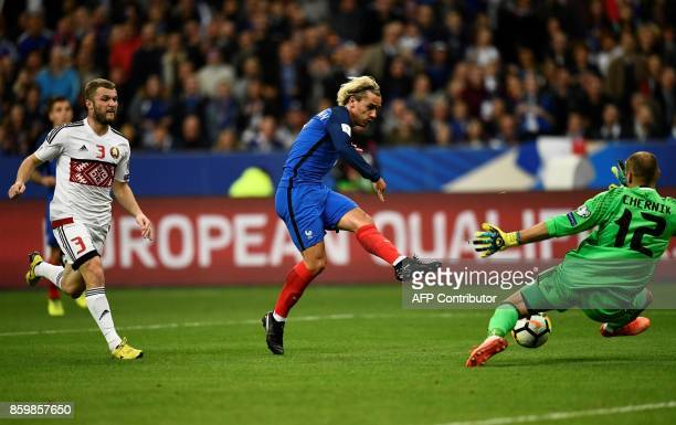France's forward Antoine Griezmann shoots and scores a goal during the FIFA World Cup 2018 qualification football match between France and Belarus at...