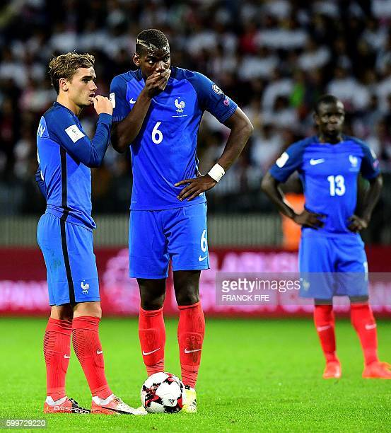 France's forward Antoine Griezmann speaks with France's midfielder Paul Pogba during the FIFA World Cup 2018 qualifying football match Belarus vs...