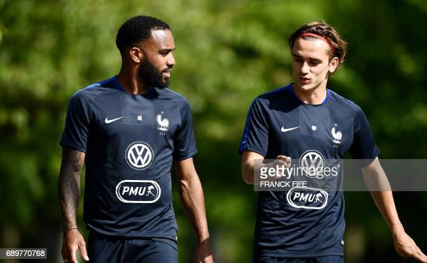 France's forward Antoine Griezmann talks with with France's forward Alexandre Lacazette before a training session in ClairefontaineenYvelines on May...