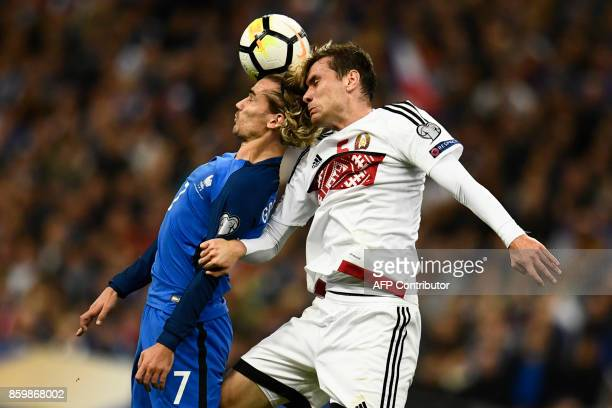 TOPSHOT France's forward Antoine Griezmann vies for the ball with Belarus' defender Maksim Volodko during the FIFA World Cup 2018 qualification...