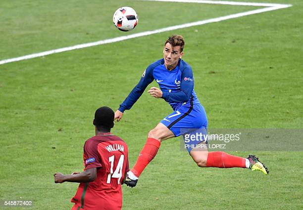 TOPSHOT France's forward Antoine Griezmann vies for the ball with Portugal's midfielder William Carvalho during the Euro 2016 final football match...