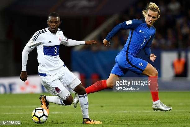 France's forward Antoine Griezmann vies with Luxembourg's defender Christopher Martins Pereira during the FIFA World Cup 2018 qualifying football...