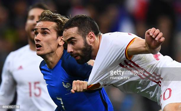 TOPSHOT France's forward Antoine Griezmann vies with Spain's defender Daniel Carvajal during the friendly football match France vs Spain on March 28...
