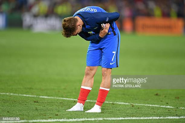 France's forward Antoine Griezmann who scored the team's two goals acknowledges the fans after France beat Germany 20 in the Euro 2016 semifinal...