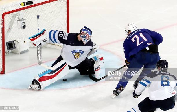 France's forward Antoine Rousel scores a goal in front Finland's goalkeeper Joonas Korpisalo during the IIHF Men's World Championship group B match...