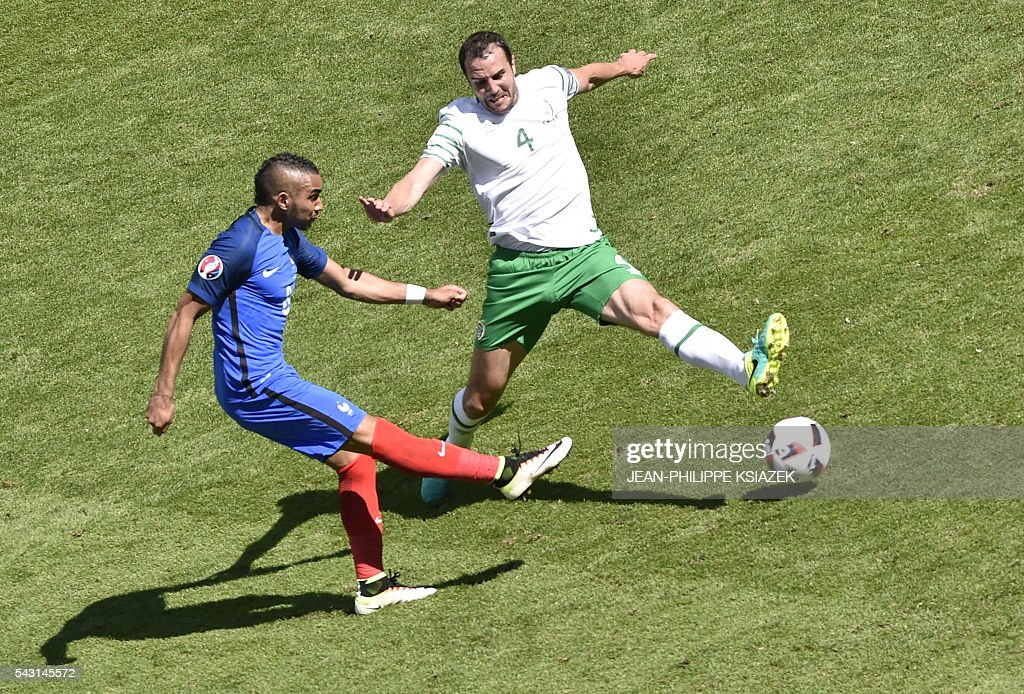 France's forward Dimitri Payet and Ireland's defender John O'Shea vie for the ball during the Euro 2016 round of 16 football match between France and Republic of Ireland at the Parc Olympique Lyonnais stadium in Décines-Charpieu, near Lyon, on June 26, 2016. France won the match 2-1. / AFP / JEAN