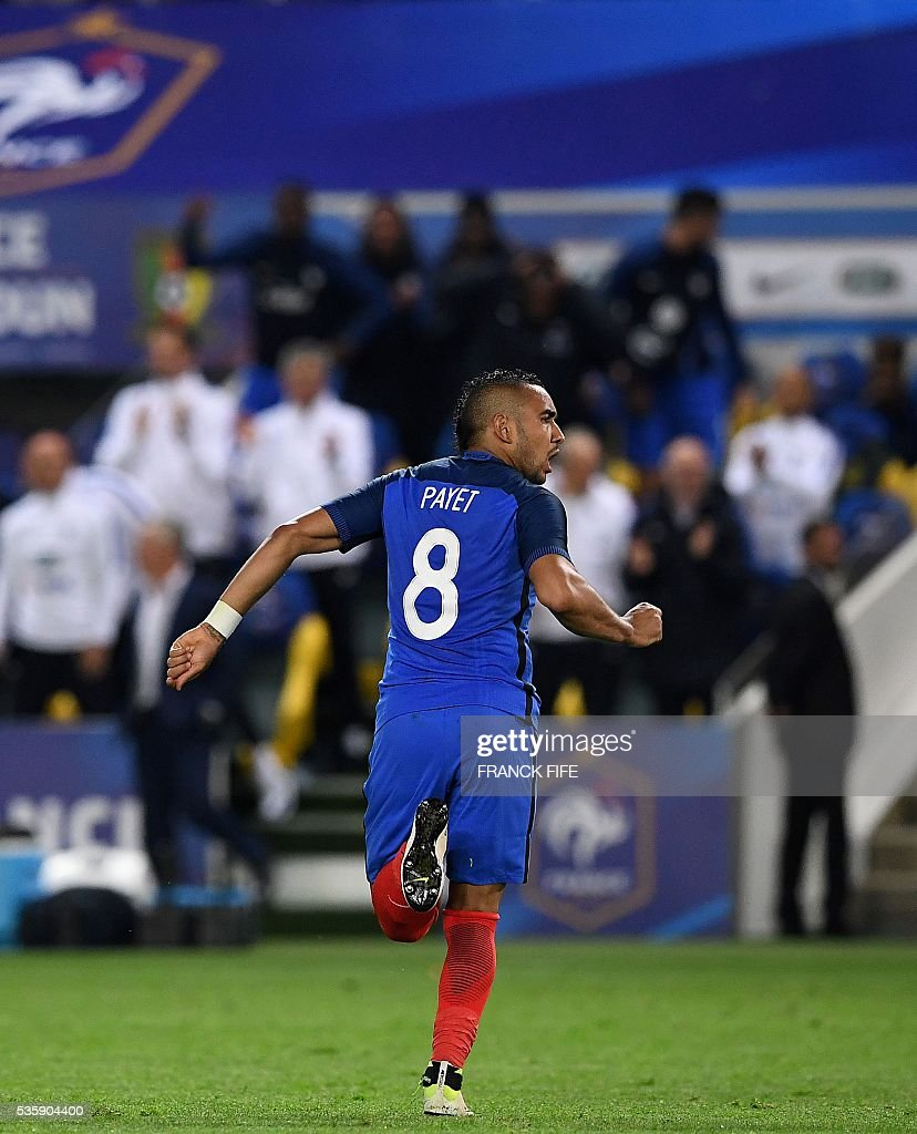 France's forward Dimitri Payet celebrates after scoring a goal during the International friendly football match between France and Cameroon at the Beaujoire stadium, in Nantes, western France, on May 30, 2016 as part of the French team's preparation for the upcoming Euro 2016 European football championships. / AFP / FRANCK
