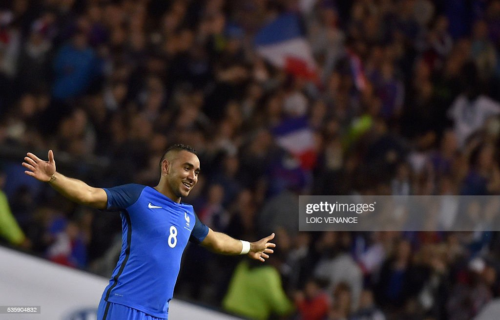 France's forward Dimitri Payet celebrates after scoring a goal during the International friendly football match between France and Cameroon at the Beaujoire stadium, in Nantes, western France, on May 30, 2016 as part of the French team's preparation for the upcoming Euro 2016 European football championships. / AFP / LOIC