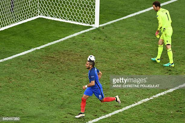 France's forward Dimitri Payet celebrates after scoring against Albania's goalkeeper Etrit Berisha during during the Euro 2016 group A football match...