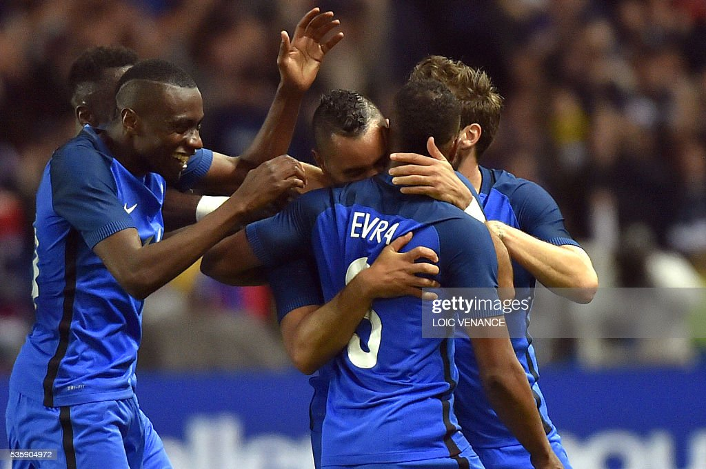 France's forward Dimitri Payet celebrates with his teammates after scoring a goal during the International friendly football match between France and Cameroon at the Beaujoire stadium, in Nantes, western France, on May 30, 2016 as part of the French team's preparation for the upcoming Euro 2016 European football championships. / AFP / LOIC