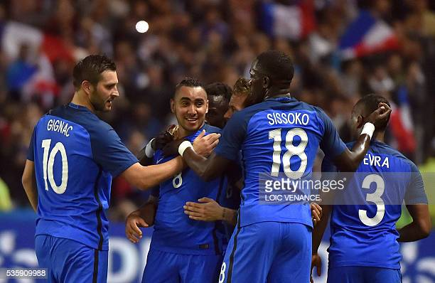 France's forward Dimitri Payet celebrates with his teammates forward Andre Pierre Gignac midfielder Moussa Sissoko and defender Patrice Evra after...