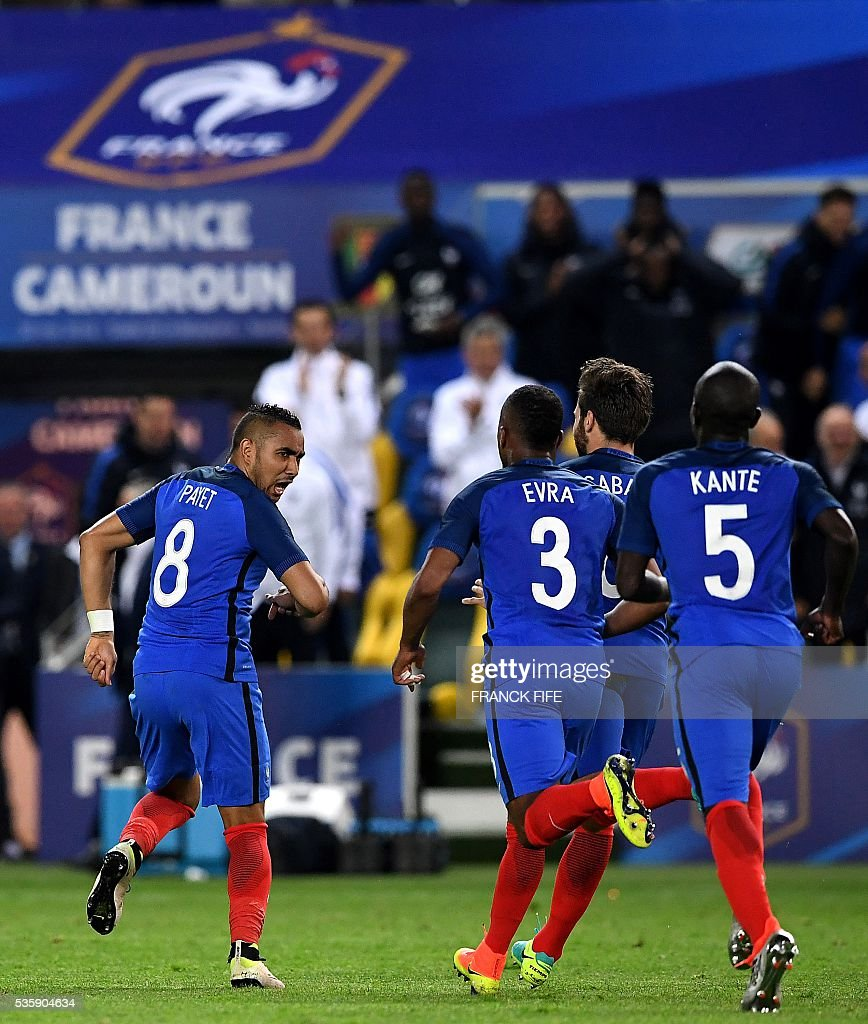 France's forward Dimitri Payet (L) celebrates with his teammates midfielder N'Golo Kante (front R) defender Patrice Evra (C) midfielder Yohan Cabaye (rear R) after scoring a goal during the International friendly football match between France and Cameroon at the Beaujoire stadium, in Nantes, western France, on May 30, 2016 as part of the French team's preparation for the upcoming Euro 2016 European football championships. / AFP / FRANCK