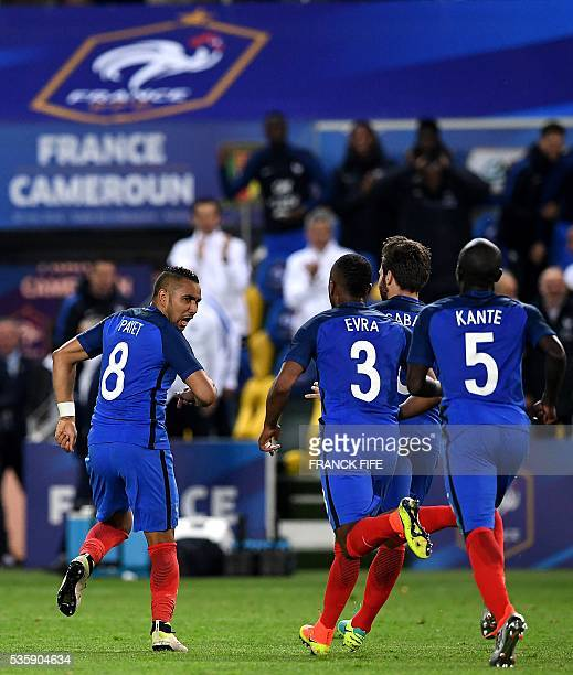 France's forward Dimitri Payet celebrates with his teammates midfielder N'Golo Kante defender Patrice Evra midfielder Yohan Cabaye after scoring a...