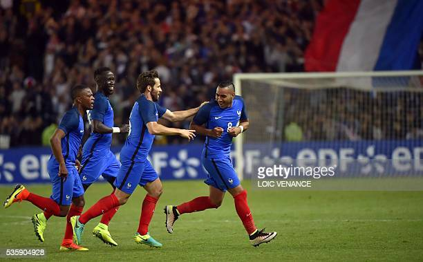 France's forward Dimitri Payet celebrates with his teammates midfielder Yohan Cabaye midfielder N'Golo Kante and defender Patrice Evra after scoring...