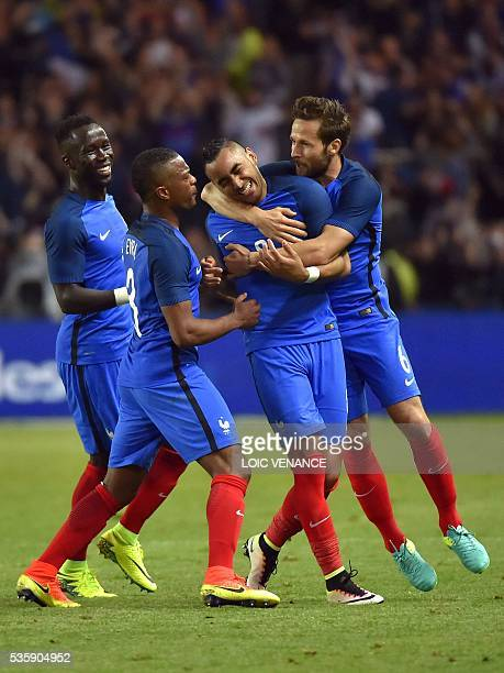France's forward Dimitri Payet celebrates with his teammates midfielder Yohan Cabaye defender Patrice Evra and midfielder N'Golo Kante after scoring...
