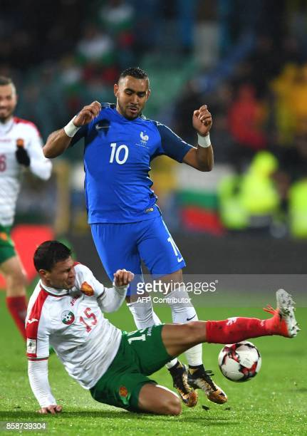 France's forward Dimitri Payet fights for the ball with Bulgaria's defender Vasil Bozhikov during the FIFA World Cup 2018 qualifying football match...
