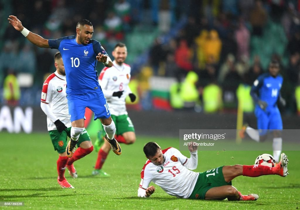 France's forward Dimitri Payet (L) fights for the ball with Bulgaria's defender Vasil Bozhikov during the FIFA World Cup 2018 qualifying football match between Bulgaria and France at The Vasil Levski Stadium in Sofia on October 7, 2017. / AFP PHOTO / Dimitar DILKOFF