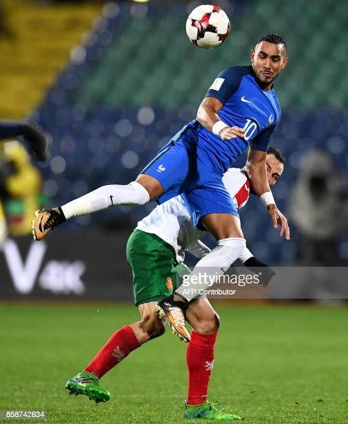France's forward Dimitri Payet fights for the ball with Bulgaria's midfielder Simeon Slavchev during the FIFA World Cup 2018 qualifying football...