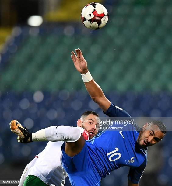 France's forward Dimitri Payet jumps for the ball during the FIFA World Cup 2018 qualifying football match between Bulgaria and France at The Vasil...
