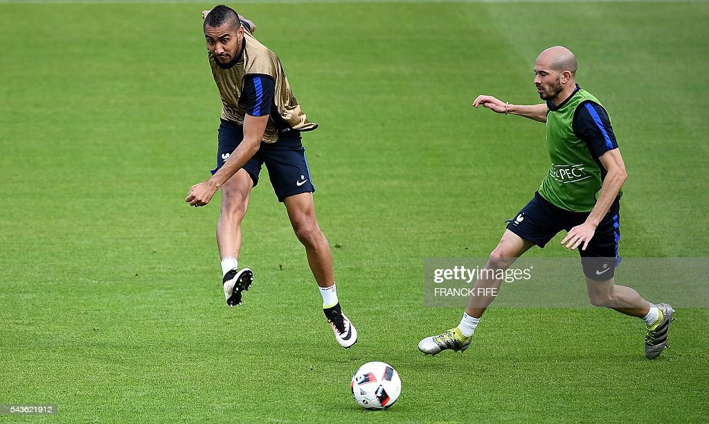 France's forward Dimitri Payet (L) kicks the ball next to France's defender Christophe Jallet during a training session in Clairefontaine-en-Yvelines, southwest of Paris, on June 29, 2016, during the Euro 2016 football tournament. / AFP / FRANCK