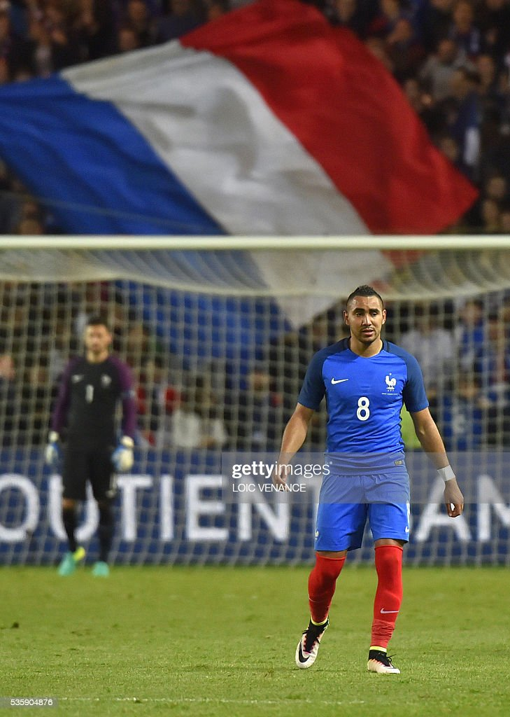France's forward Dimitri Payet reacts after scoring a goal during the International friendly football match between France and Cameroon at the Beaujoire stadium, in Nantes, western France, on May 30, 2016 as part of the French team's preparation for the upcoming Euro 2016 European football championships. / AFP / LOIC