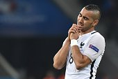 TOPSHOT France's forward Dimitri Payet reacts during the Euro 2016 group A football match between Switzerland and France at the PierreMauroy stadium...