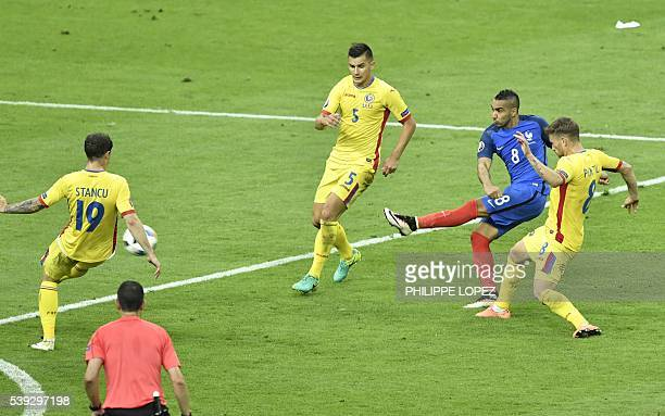 France's forward Dimitri Payet shoots to score during the Euro 2016 group A football match between France and Romania at Stade de France in...