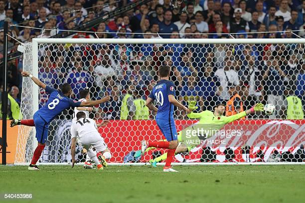 France's forward Dimitri Payet shoots to score France's second goal during the Euro 2016 group A football match between France and Albania at the...