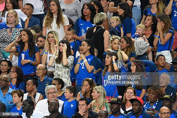France's forward Dimitri Payet's wife Ludivine Payet France's defenders Lucas Digne's wife Tiziri Digne and France's forward Kingsley Coman's wife...