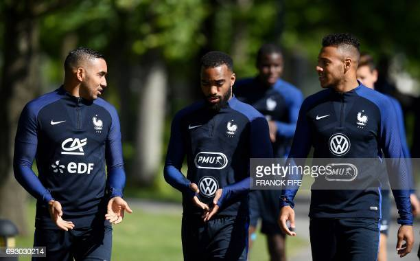 France's forward Dumitri Payet France's forward Alexandre Lacazette and France's midfielder Corentin Tolisso speak together during a training session...