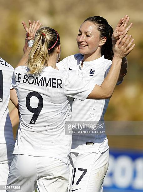 France's forward Eugenie Le Sommer celebrates her goal with teammate midfielder Gaetane Thiney during the Algarve Cup football match Japan vs France...