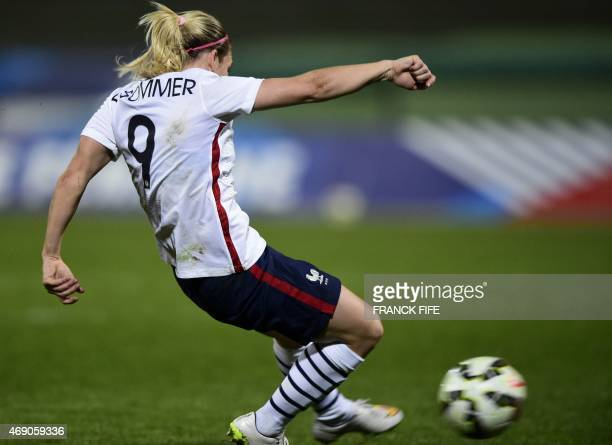 France's forward Eugenie Le Sommer shoots to score a goal during the friendly football match France vs Canada on April 9 2015 at the Stade...