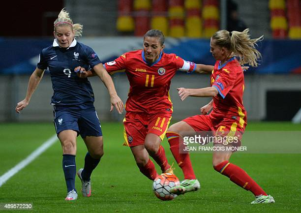 France's forward Eugenie Le Sommer vies with Romania's forward Florentina Olar and Romania's defender Olivia Oprea during the Women's Euro 2017...