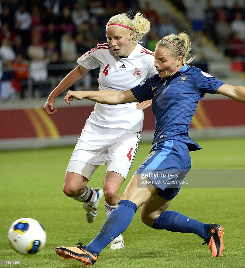 France's forward Eugnie Le Sommer and Denmark's defender Christina Orntoft (L) vie for the ball during the UEFA Women's European Championship Euro 2013 quarter final football match France vs Denmark on July 22, 2013 in Linkoping, Sweden.
