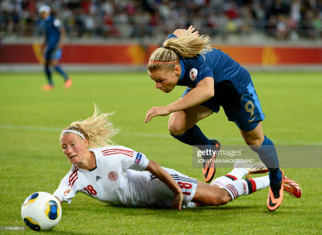 France's forward Eugnie Le Sommer (R) and Denmark's defender Theresa Nielsen vie for the ball during the UEFA Women's European Championship Euro 2013 quarter final football match France vs Denmark on July 22, 2013 in Linkoping, Sweden.