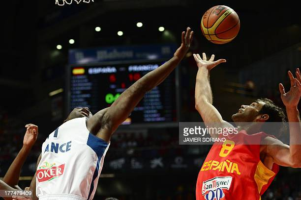 France's forward Florent Pietrus vies with Spain's guard Jose Manuel Calderon during the friendly basketball match Spain vs France at the Palacio de...