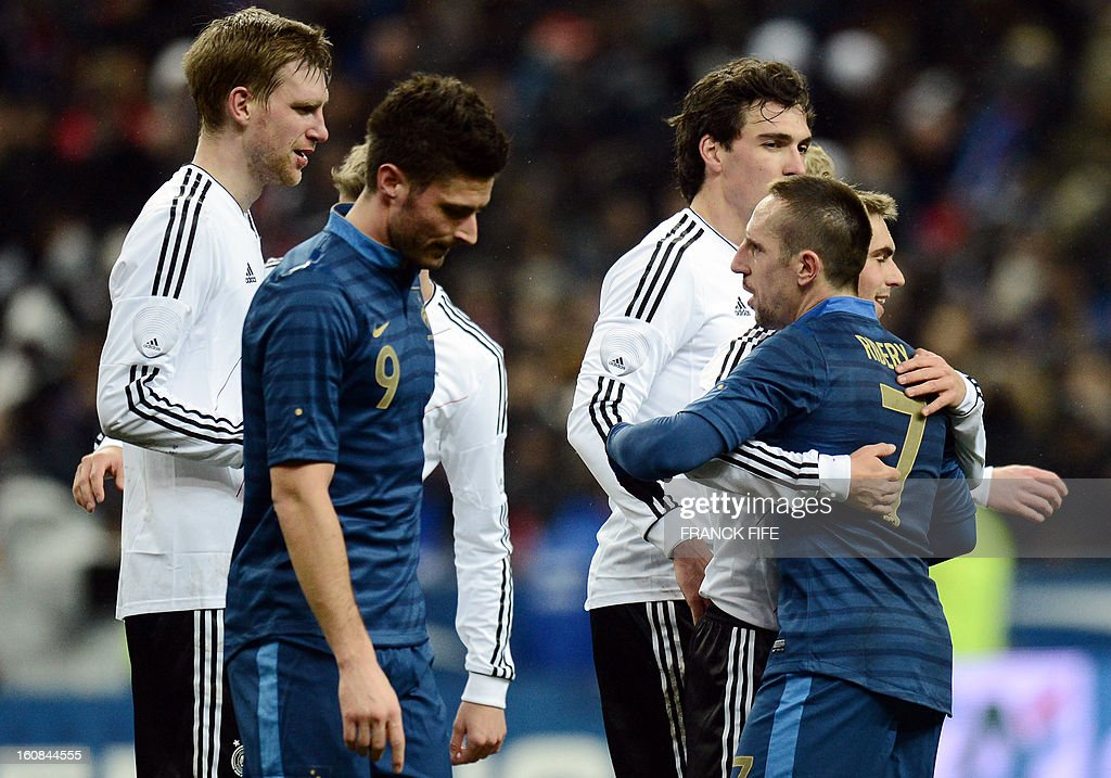 France's forward Franck Ribery (R) congratulates Germany's defender and captain Philipp Lahm after a friendly international football match between France and Germany on February 6, 2013 at the Stade de France in Saint-Denis, near Paris.